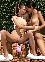 Gorgeous ladies nude and make love in garden